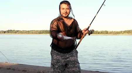 zander : man showing his catch on fishing