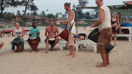 frick : Goa, India – February 27, 2016: Unidentified man playing on drum at the Arambol beach.