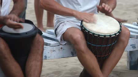 frick : Unidentified man playing on drum