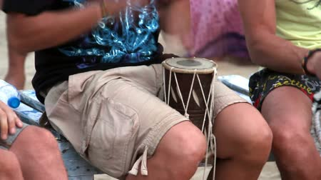 goa beach : Unidentified man playing on drum