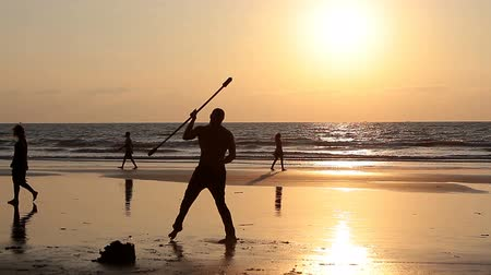 frick : Goa, India - February 10, 2016: Unidentified man spinning pole on the beach. Stock Footage