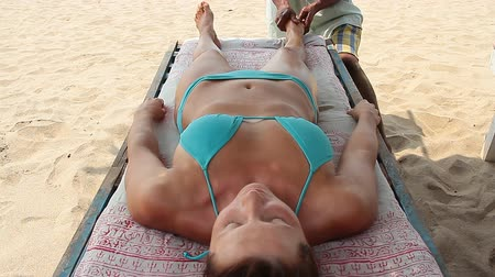 goa beach : Close up of therapists hands doing legs massage on woman.