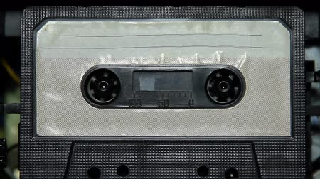 лента : vintage audio cassette tape with a blank white label