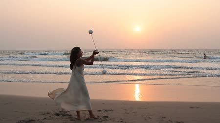 frick : Goa, India - February 15, 2016: Unidentified woman spinning poi on the beach. Stock Footage