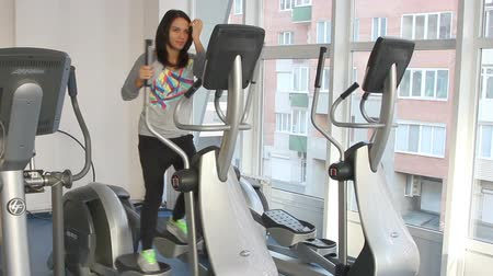 elliptical : Rostov on Don, Russian Federation - January 05, 2014: Beautiful female during exercise on elliptical trainer.