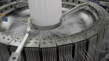 kumaş : Textile industry - yarn spools on spinning machine in a factory