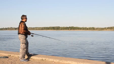 zander : man fishing on a river Stock Footage