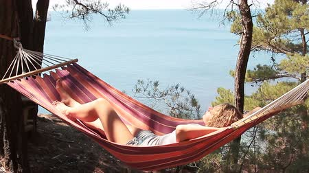 waggle : Beautiful young girl resting in a hammock