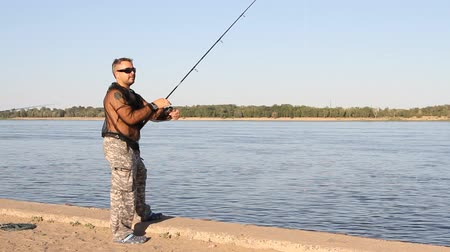 zander : Volgograd, Russian Federation – June 13, 2015: man fishing on a river
