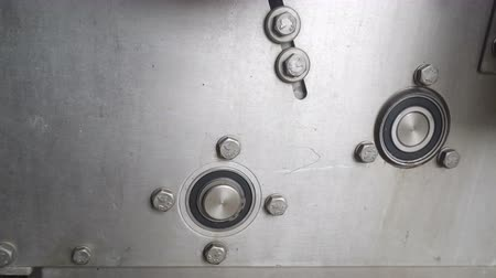 pillow block : Rotation of the bearing on the panel of the machine in production Stock Footage