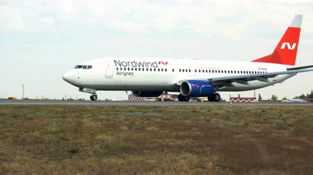 taking flight : Volgograd, Russian Federation - August 18, 2017: Nord Wind company airliner on the runway before take off