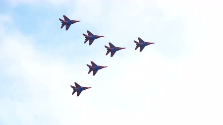 aerobatic : Volgograd, Russian Federation - February 02, 2018: Aerobatics performed by aviation group of Military-air forces of Russia Strizhi.