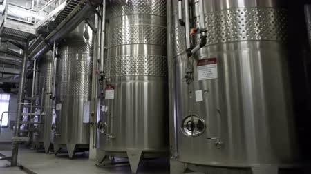 clean room : Sennoy, Russian Federation – February 14, 2018: Steel barrels for fermentation of wine in winemaker factory Stock Footage