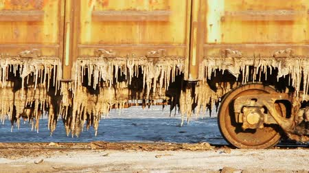 cristais : Nizhniy Baskunchak, Russian Federation - August 16, 2015: Old rusty train wagons with stalactites of salt at the lake Baskunchak