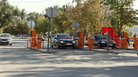 ücretli : Volgograd, Russian Federation - September 27, 2015: Automatic security barrier at the parking Stok Video
