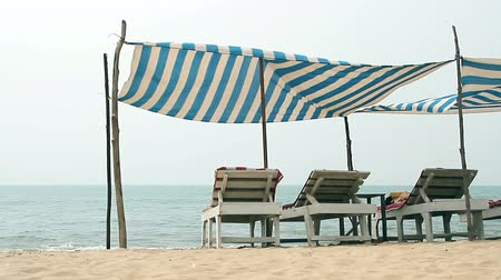 slunečník : Chair with awning on the Beach