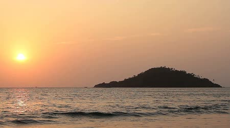 dark island : Sunset on the Beach Stock Footage