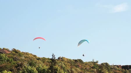 hang gliding : Paragliding over the mountains against clear blue sky
