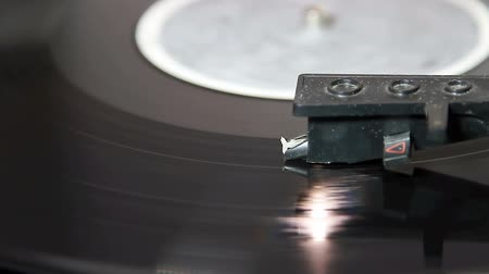 hi fi : turntable with stylus running along a vinyl record