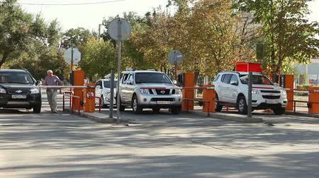 barrier gate : Volgograd, Russian Federation - September 27, 2015: Automatic security barrier at the parking Stock Footage