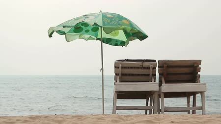 parasol : Goa, India – February 10, 2016: Chair with Umbrella near the Beach Stock Footage
