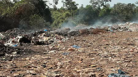 corroded : Large garbage dump waste with smoke Stock Footage