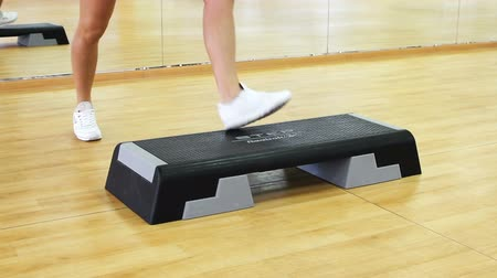 aerobic : Rostov on Don, Russian Federation - January 05, 2014: Beautiful female legs on the step board during exercise.