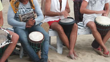 frick : Goa, India – February 28, 2015: Unidentified man playing on drum at the beach.