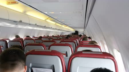 бортовой : Moscow, Russian Federation – October 18, 2017: Interior of airplane with passengers on seats.
