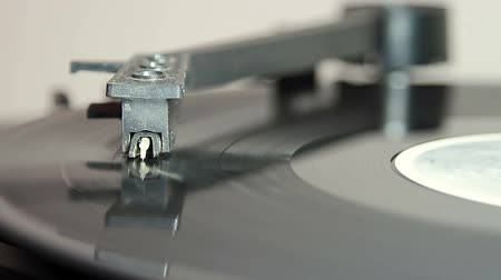 gramophone : turntable with stylus running along a vinyl record