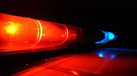 police department : Police blue and red lamp flashing spinning in the dark Stock Footage