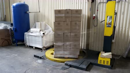 polyethylene : Sennoy, Russian Federation – February 14, 2018: Packing of boxes with wine on a pallet in the polymeric film