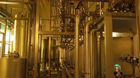 distillation : Modern large filter system inside of plant with yellow lighting