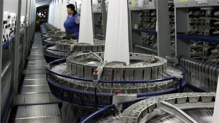 tekstil : VOLZHSKY, Russian Federation - OCTOBER 27, 2014: Textile industry - yarn spools on spinning machine in a factory