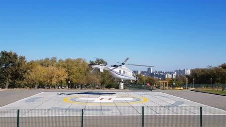 takeoff area : Volgograd, Russian Federation – October 19, 2018: Takeoff from the special area of the disaster medicine helicopter Stock Footage