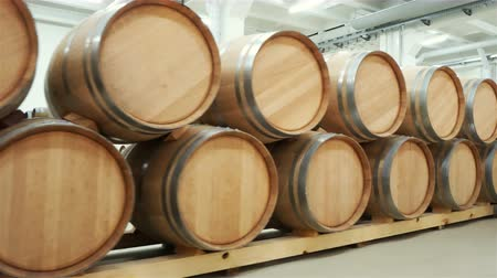 gestapelt : Wine barrels stacked in the old cellar of the winery