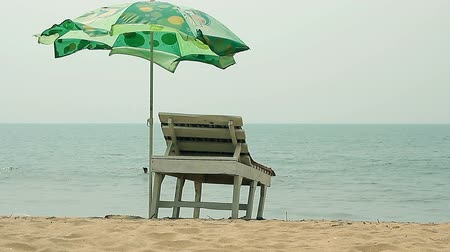 trópicos : Goa, India – February 10, 2016: Chair with Umbrella near the Beach Vídeos