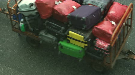 nakládané : Suitcases (Luggage) traffic on an electromobile trolley in the airport before loading to the plane