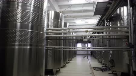 дрожжи : Steel barrels for fermentation of wine in winemaker factory