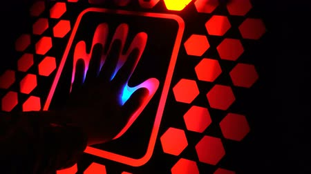 fingerprinting : Man put his hand on the futuristic fingerprint scanning device biometric security in the dark