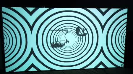 algoritmo : Psychedelic animation on a huge monitor in a dark room.