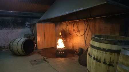 roasting : The process of roasting oak barrels for wine in a cooperage