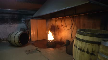 barrica : The process of roasting oak barrels for wine in a cooperage