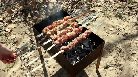 espetos : beef kababs on the grill