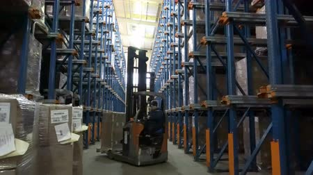 Sennoy, Russian Federation – February 14, 2018: Work of loaders on loading pallets with cardboard boxes on racks in a modern warehouse