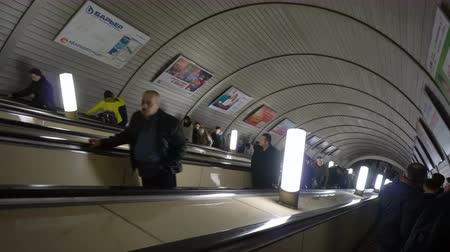 metropolitano : Moscow, Russian Federation – March 17, 2017: People go down the escalator to the underground metro station Stock Footage