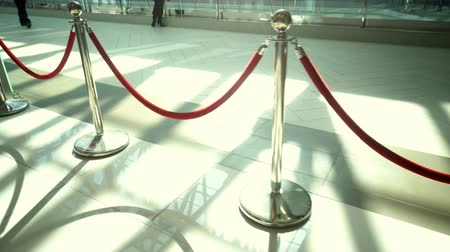 Silver metal stanchions with red velvet rope for VIP access