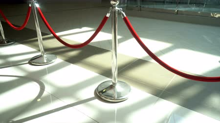 admission : Silver metal stanchions with red velvet rope for VIP access