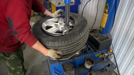 pneus : Volgograd, Russian Federation – April 02, 2017: Tire service in modern equipment