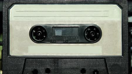 устаревший : vintage audio cassette tape with a blank white label